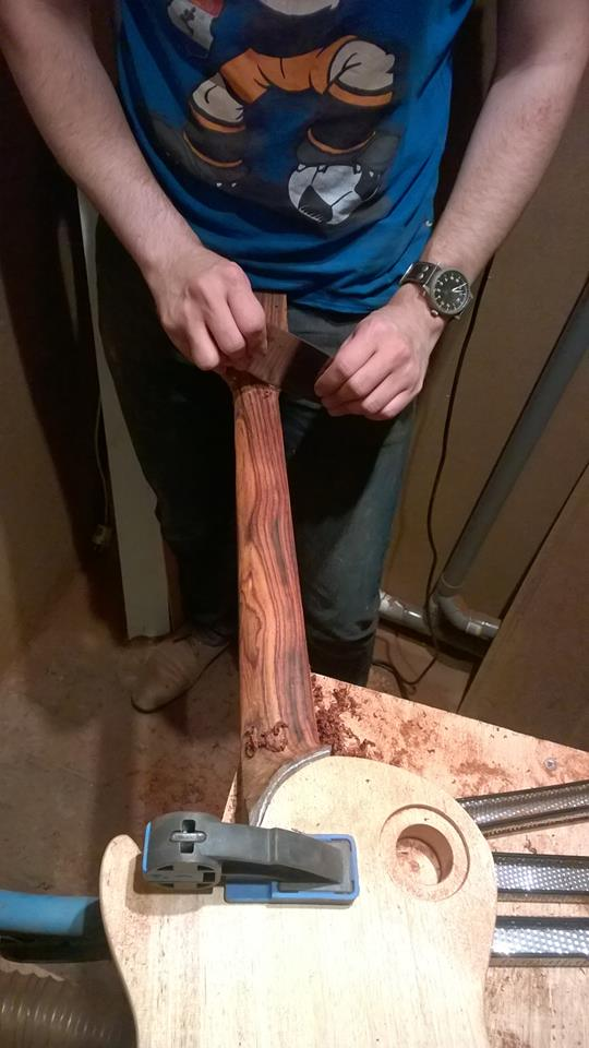 Scraping and sanding are all part of the job of getting a guitar ready for finishing.